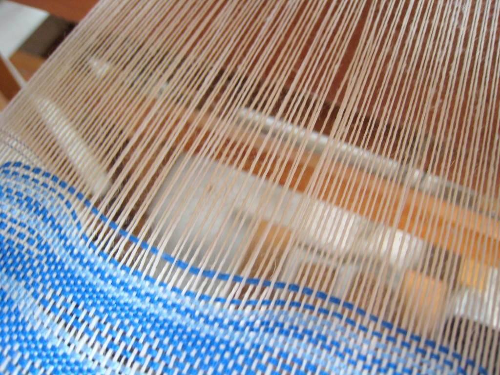 Weaving Cloth with Wavy Wefts, close up