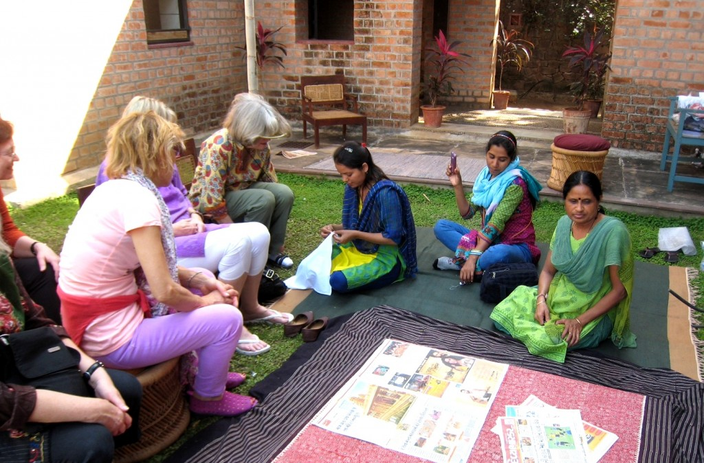 5.1 girls on the grass teaching us embroidery