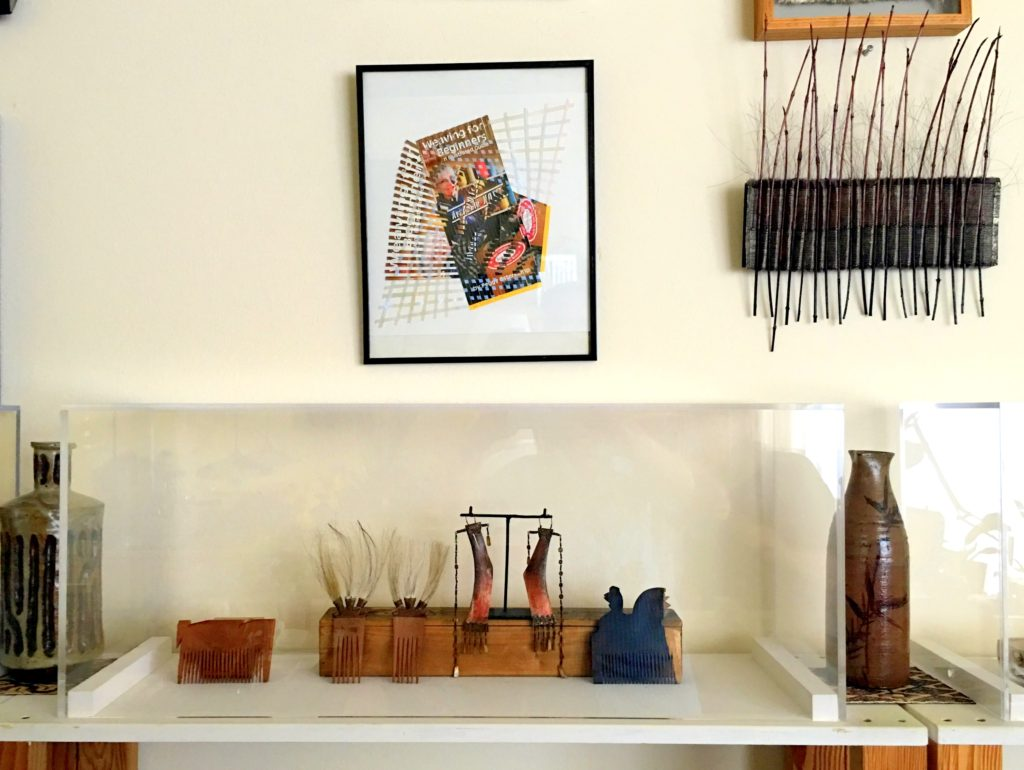 Case with earrings and hair pieces from the Philippines. combs from India, Collage by Milton Sonday, textile art by Adela Akers. Japanese sake bottle and vase.
