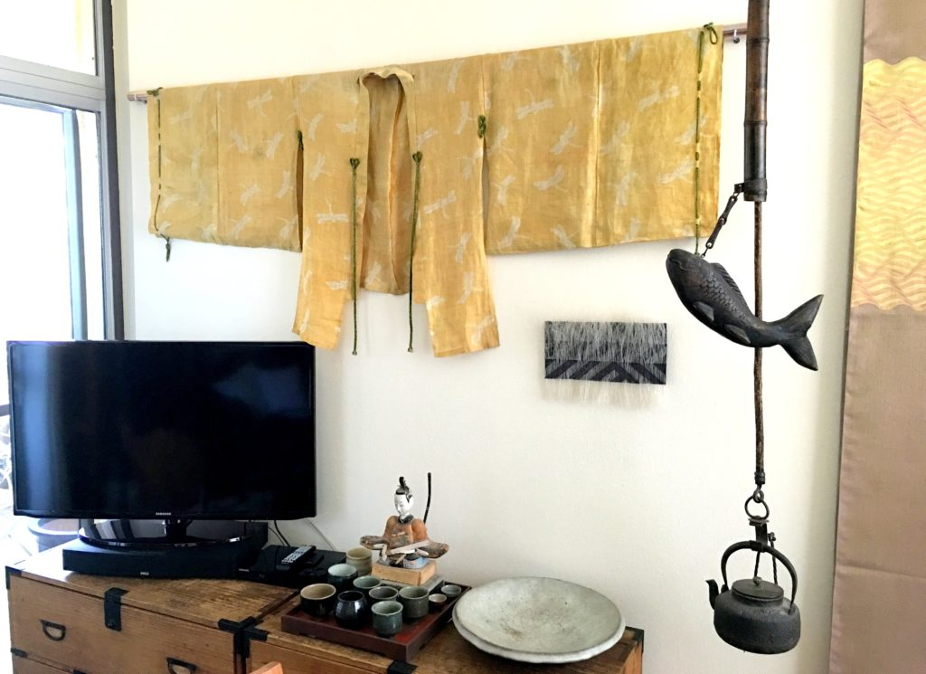 Japanese things. Ceremonial kimono with fireflies design, obi made with fan reed, tea pot with fish lever to adjust height. Art piece by Adela Akers.